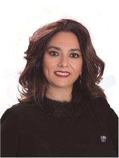 Claudia Mariel Vásquez Soliz - RE/MAX Tierra Nueva