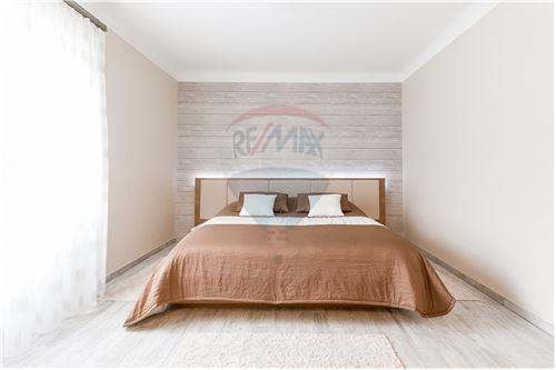 RE/MAX Premium, Maison en vente à Bettendorf