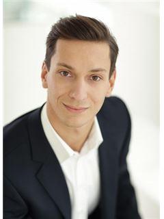 Daniel Schweiger - RE/MAX Classic