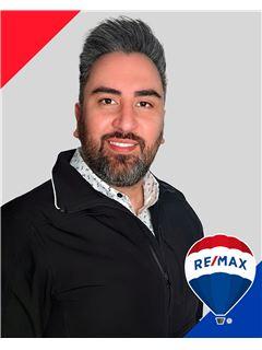 Fabian Flores Orellana - RE/MAX - SIGNATURE