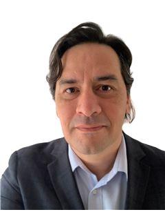 Broker/Owner - Cristian Ruiz - RE/MAX - CENTRAL