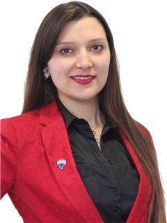 Gabriela Sarmiento - RE/MAX - FIRST