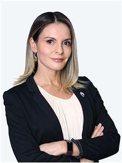 Claudia Valenzuela - RE/MAX - CENTRAL