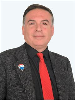 Adolfo Zarges - RE/MAX - CENTRAL
