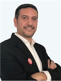 Carlos Villarroel - RE/MAX - CENTRAL