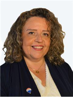 Claudia Ortiz - RE/MAX - CENTRAL
