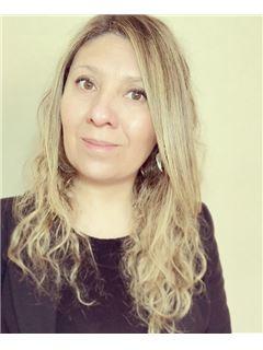 Carolina Escalona - RE/MAX - PLUS