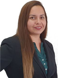 Texia Ortiz - RE/MAX - FIRST