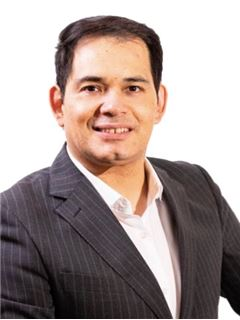 Christian Cariola - RE/MAX - TITANIO