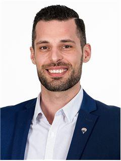 Michael Ruetz - RE/MAX Properties - Reinach