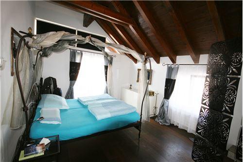 Schlafzimmer mit direktem Zugang zur Dachterrasse