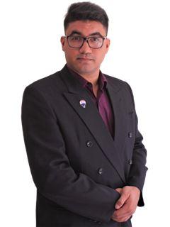Carlos Arroyo - RE/MAX SEVEN