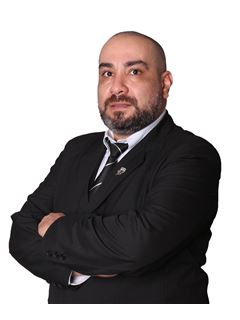 Eduardo Dominguez - RE/MAX ELITE