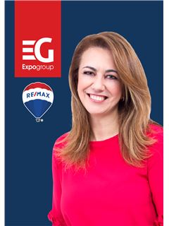 Paula Minau - RE/MAX - Expo