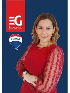 Associate in Training - Ligia Fonseca - RE/MAX - Expo