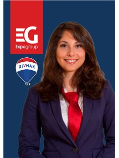 Cathy Fernandes - RE/MAX - Expo