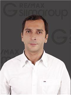 Miguel Lara - RE/MAX - Capital
