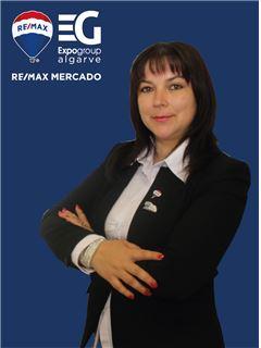 Oksana Fernandes - RE/MAX - Mercado