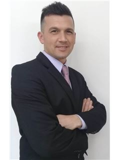 Yamil Giso - RE/MAX Elite