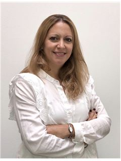 Roxina Sainz - RE/MAX Premium