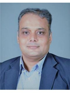Mrugesh Patel - RE/MAX Realty Solutions(Ahmedabad)