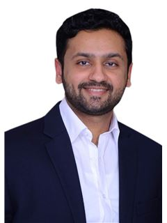 Dhrumil Pandya - RE/MAX Realty Solutions(Ahmedabad)
