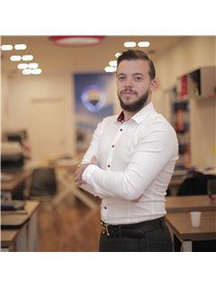 Aron Daja - RE/MAX Home Group
