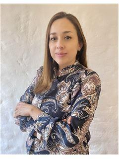 Mariangela Muñoz Valero - RE/MAX Planet