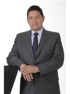 Agente Inmobiliario - Alexander Moreno Gonzalez - RE/MAX Top Inmobiliaria