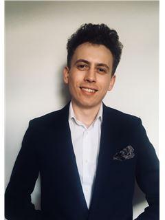Szymon Chmielewski - RE/MAX Experts
