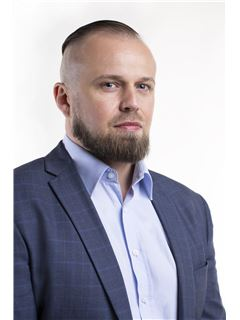 Mateusz Stanek - RE/MAX Carbon