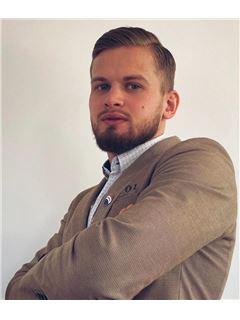 Dawid Zyzański - RE/MAX Invest
