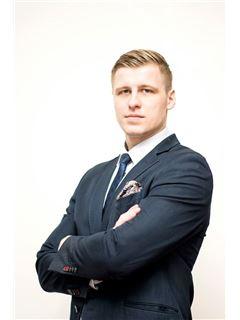 Wojciech Szypuła - RE/MAX Invest