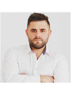 Adam Przewoznik - RE/MAX Invest