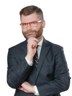 Krzysztof Jaguś - RE/MAX Invest