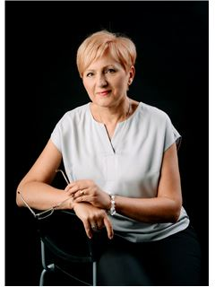 Ewa Michałowska - RE/MAX Invest