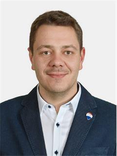 Piotr Więcław - RE/MAX Partners