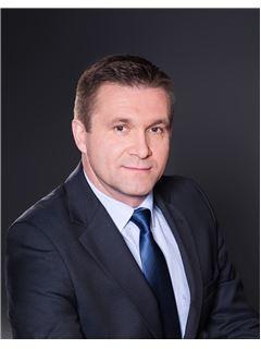 Grzegorz Sikorski - RE/MAX Capital