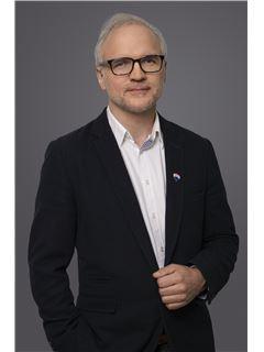Krzysztof Szymańczyk - RE/MAX Best