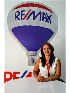 Monica Mora - RE/MAX Kigal