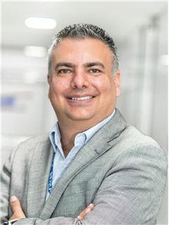 Mario Cofré - RE/MAX Capital