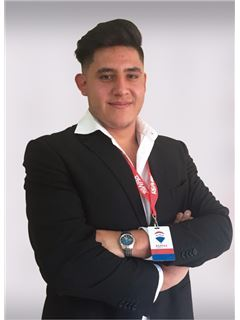 Kevin Fidel Auz - RE/MAX Infinity