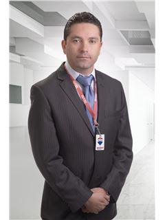 Juan Carlos Salgado - RE/MAX Platinum