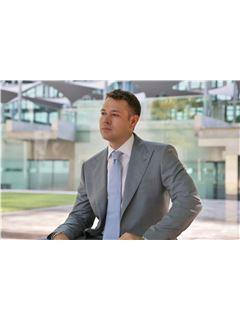 Associate - Marcus Pedersen - RE/MAX Eagles